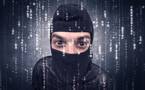 Burglar in action with encoded concept and his tools in his hand Credit: Shutterstock