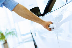 Close up human hand opening car door Image: Shutterstock