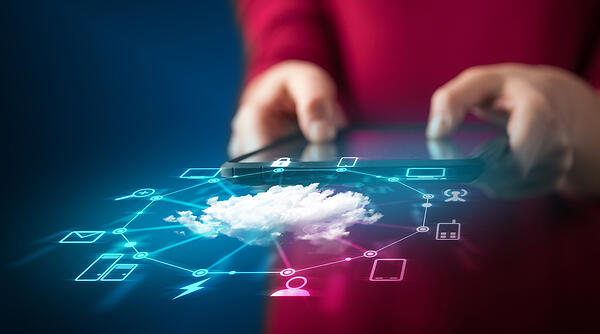Close up of hand holding tablet with cloud network technology concept on background Image: Shutterstock