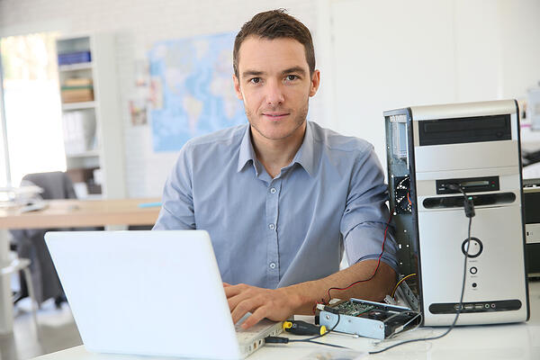 Engineer proceeding to data recovery from computer Credit: Shutterstock