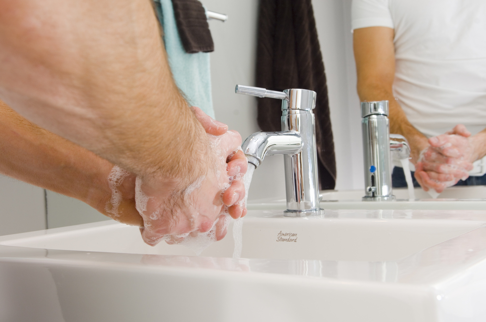 Guy washing hands in sink Image: Shutterstock