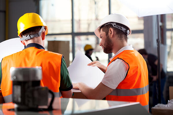 Male factory worker and supervisor are analyzing plans Image: Shutterstock