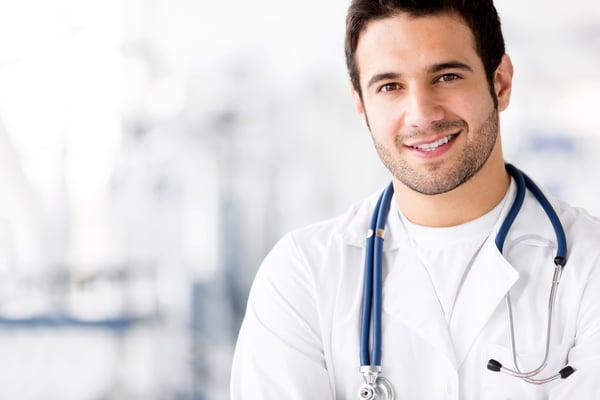 Portrait of friendly male doctor smiling Image: Shutterstock