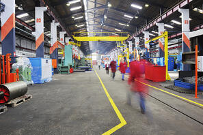 iron works steel and machine parts modern factory indoor hall Image: Shutterstock